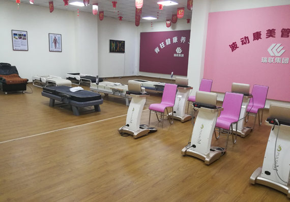 Showing room of  massage bed and pulse therapy machine